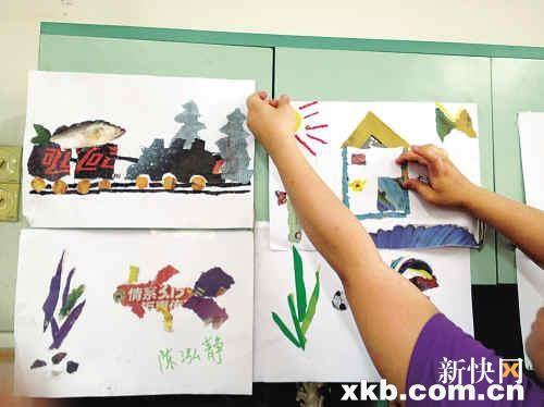 须是要   ■在老师指导下,小朋友在制作撕报画,很是认真.